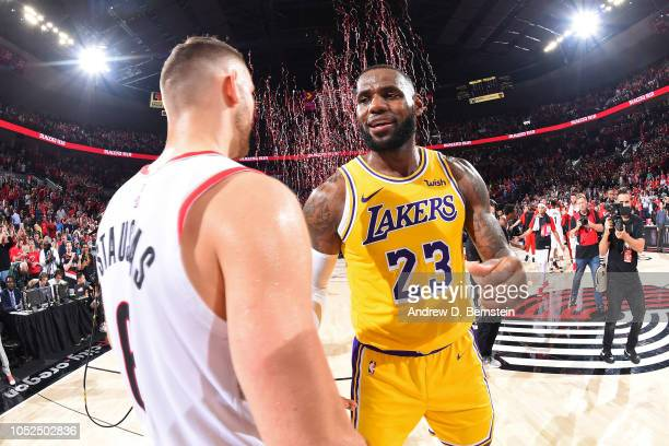 Nik Stauskas of the Portland Trail Blazers talks with LeBron James of the Los Angeles Lakers after the game on October 18 2018 at the Moda Center...