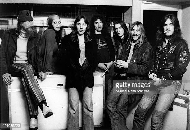 "Nik Turner, Stacia, Alan Powell , Simon House, Simon King, Dave Brock, and Lemmy Kilmister of the space rock band ""Hawkwind"" pose for a portrait in..."