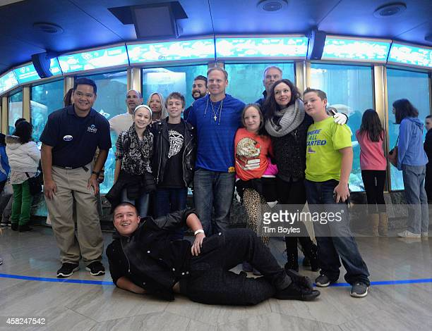 Nik Wallenda and his family and friends pose for a photograph at the Shedd Aquarium on November 1, 2014 in Chicago, Illinois. Wallenda says it's...