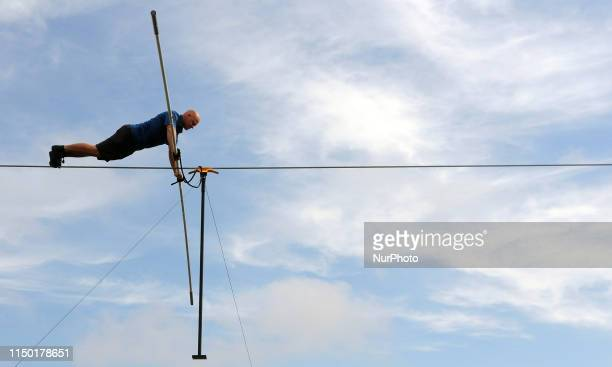 Nik Wallenda does pushups while practicing on the high wire at Nathan Benderson Park on June 15 2019 in Sarasota Florida This is Wallenda's final...