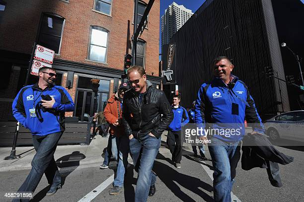 Nik Wallenda laughs as he walks to the production office with part of his crew in the hours before his record-breaking high wire walk along the...