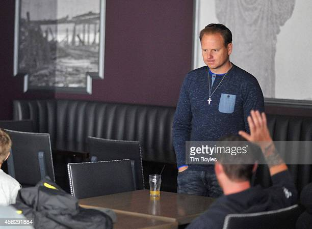 Nik Wallenda meets with his crew in the hours before his record-breaking high wire walk along the skyline on November 2, 2014 in Chicago, Illinois.