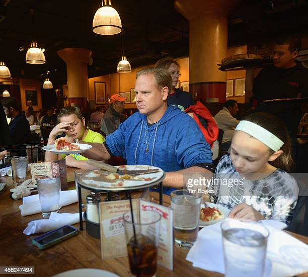Nik Wallenda passes a slice of pizza to his wife on November 1, 2014 in Chicago, Illinois. Wallenda says it's important to do other things to take...