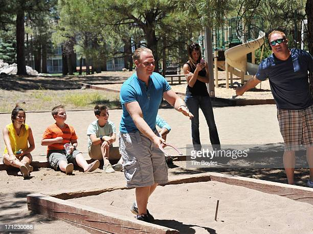 Nik Wallenda plays horseshoes with his family and friends in the hours before his historic highwire walk over the Grand Canyon June 23, 2013 in...