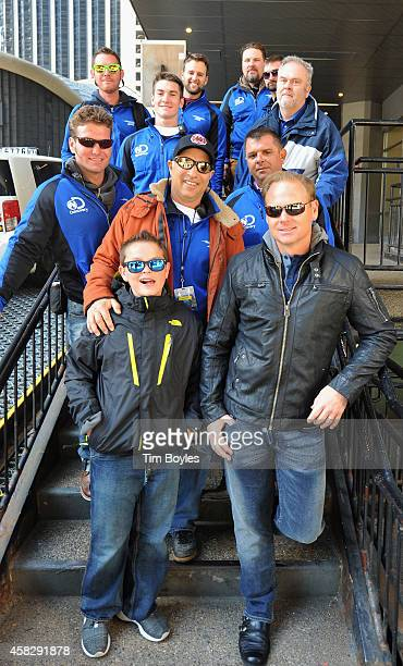 Nik Wallenda poses for a photograph with part of his crew and his son, Amadeus at the production office in the hours before his record-breaking high...