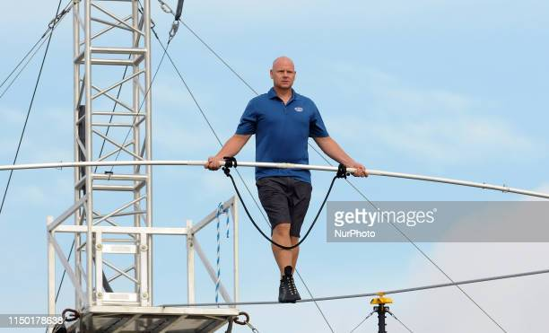 Nik Wallenda practices on the high wire at Nathan Benderson Park on June 15 2019 in Sarasota Florida This is Wallenda's final public practice before...