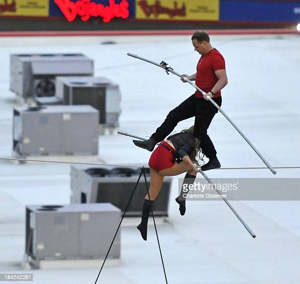 Nik Wallenda top walks the tightrope above Charlotte Motor Speedway on Saturday October 12 with his sister Lijana 140 feet above pit road during the...