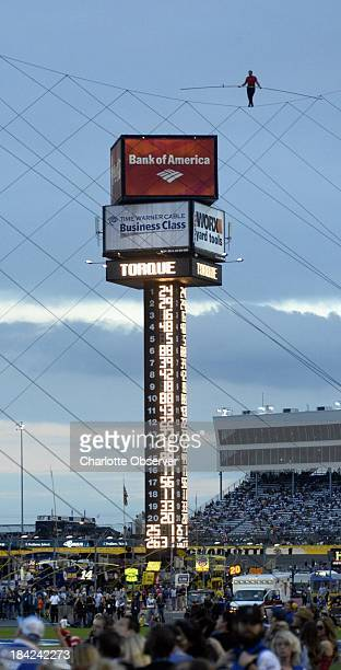 Nik Wallenda walks the tightrope above Charlotte Motor Speedway on Saturday October 12 with his sister Lijana 140 feet above pit road during the...