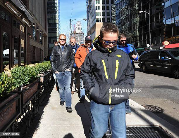 Nik Wallenda walks to the production offices with his son Amadeus and part of his crew in the hours before his record-breaking high wire walk along...