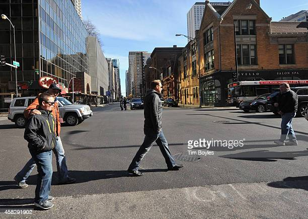 Nik Wallenda walks to the television production office in the hours before his record-breaking high wire walk at on November 2, 2014 in Chicago,...