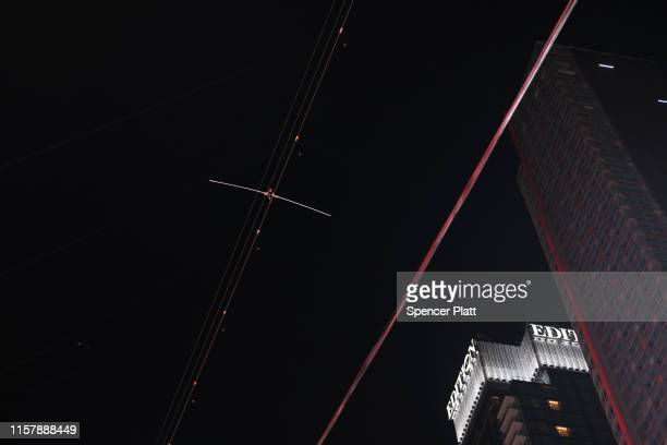 Nik Wallenda walks towards his sister Lijana Wallenda across Times Square on a high wire strung between two skyscrapers 25 stories above the pavement...