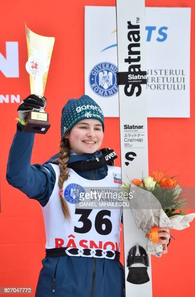 Nika Kriznar of Slovenia poses on the podium after placing third in the Ladies' HS97 ski jumping event of the Ladies' FIS World Cup Ski Jumping in...