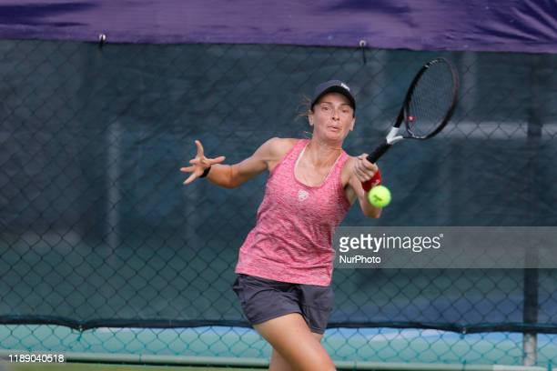Nika Kukharchuk of Russia plays a backhand in the match Singles Finals against Paige Cline of USA during The World Tennis Tournament Cancun 2019 on...