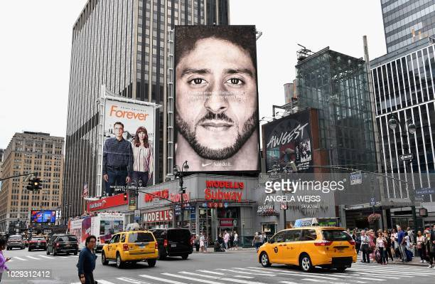 A Nike Ad featuring American football quarterback Colin Kaepernick is on diplay September 8 2018 in New York City Nike's new ad campaign featuring...