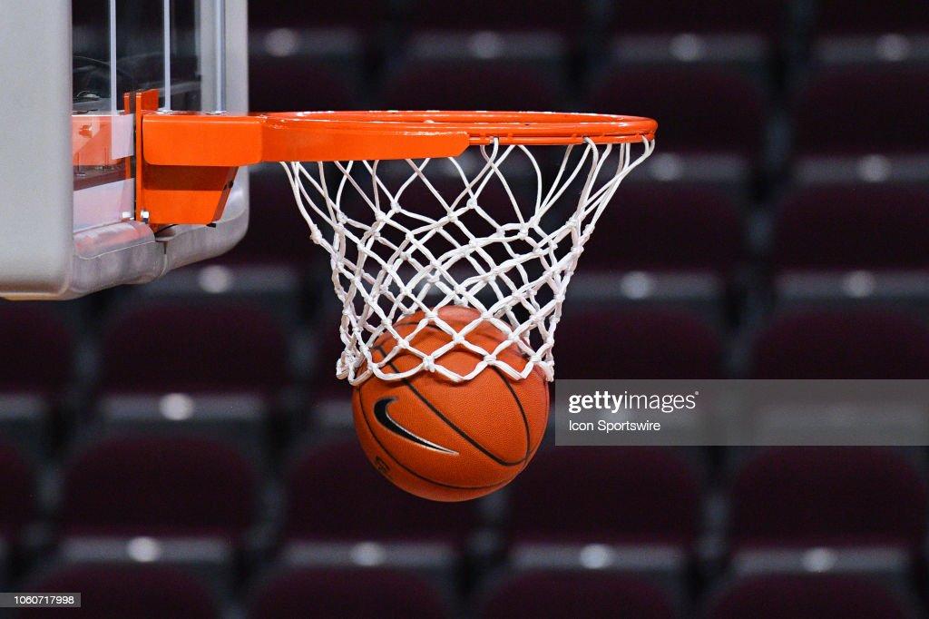 895550454b4 A Nike basketball goes through the hoop before a college basketball ...