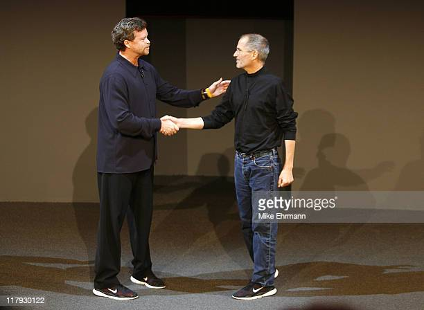 Nike CEO Mark Parker and Apple CEO Steve Jobs during the unveiling of a partnership between Nike and Apple announcing the NikeiPod which combines the...