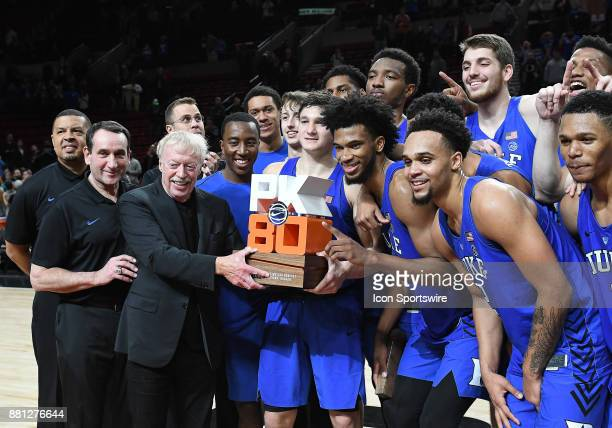 Nike chairman and cofounder Phil Knight presents the Duke Blue Devils with the Motion Bracket championship trophy at the PK80Phil Knight Invitational...