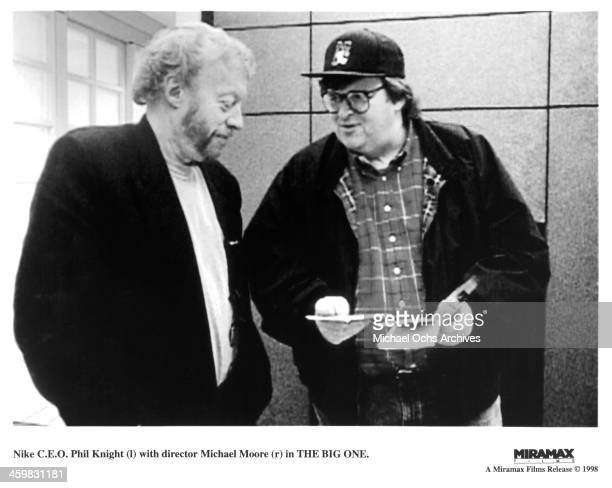 Nike Chairman Phil Knight and Director Michael Moore on set of the Documentary The Big One circa 1997
