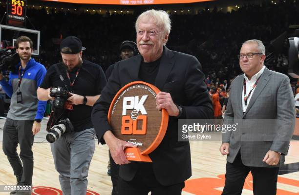 Nike cofounder Phil Knight accepts an award during the the first half of the game between the Florida Gators and the Duke Blue Devils during the...