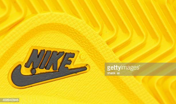 nike company name and logo - nike sports shoe stock pictures, royalty-free photos & images