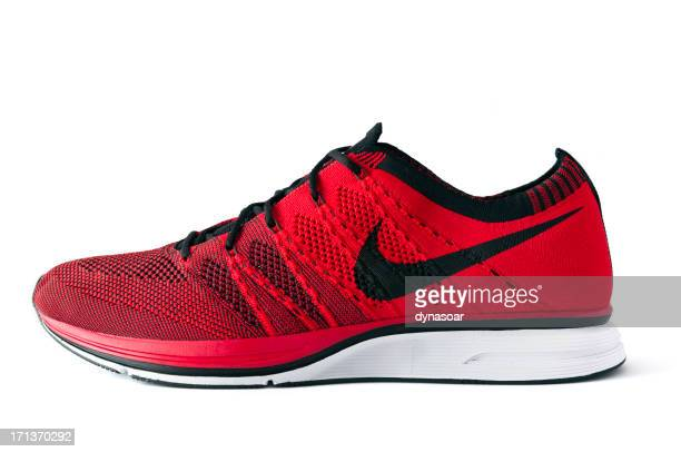 nike flyknit trainer - nike sports shoe stock pictures, royalty-free photos & images