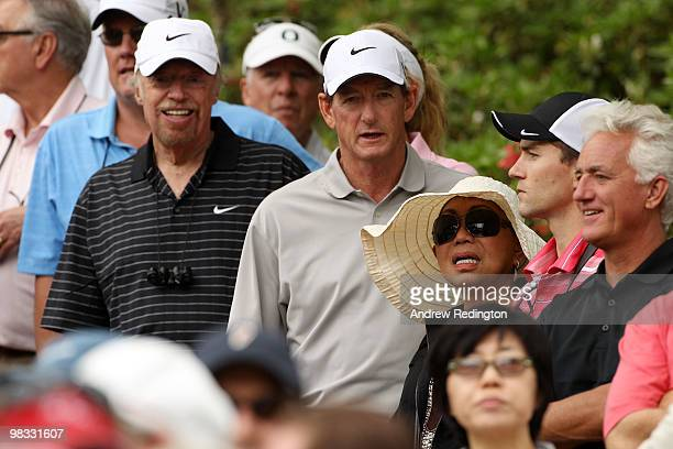 Nike founder Philip Knight Hank Haney and Katilda Woods watch the play during the first round of the 2010 Masters Tournament at Augusta National Golf...