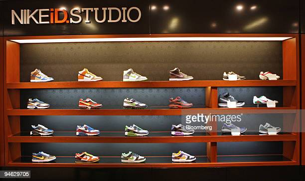 Nike ID sneakers sit on display at Niketown in New York US on Tuesday Dec 18 2007 Nike Inc the world's largest athleticshoe maker said secondquarter...
