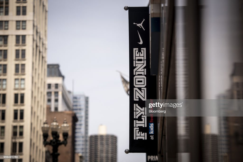 Nike Inc. Fly Zone signage hangs on display outside a Foot Locker Inc. Kids store in downtown Chicago, Illinois, U.S., on Sunday, May 13, 2018. Foot Locker Inc. is scheduled to release earnings figures on May 25. Photographer: Christopher Dilts/Bloomberg via Getty Images