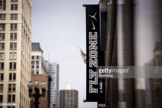 Nike Inc Fly Zone signage hangs on display outside a Foot Locker Inc Kids store in downtown Chicago Illinois US on Sunday May 13 2018 Foot Locker Inc...