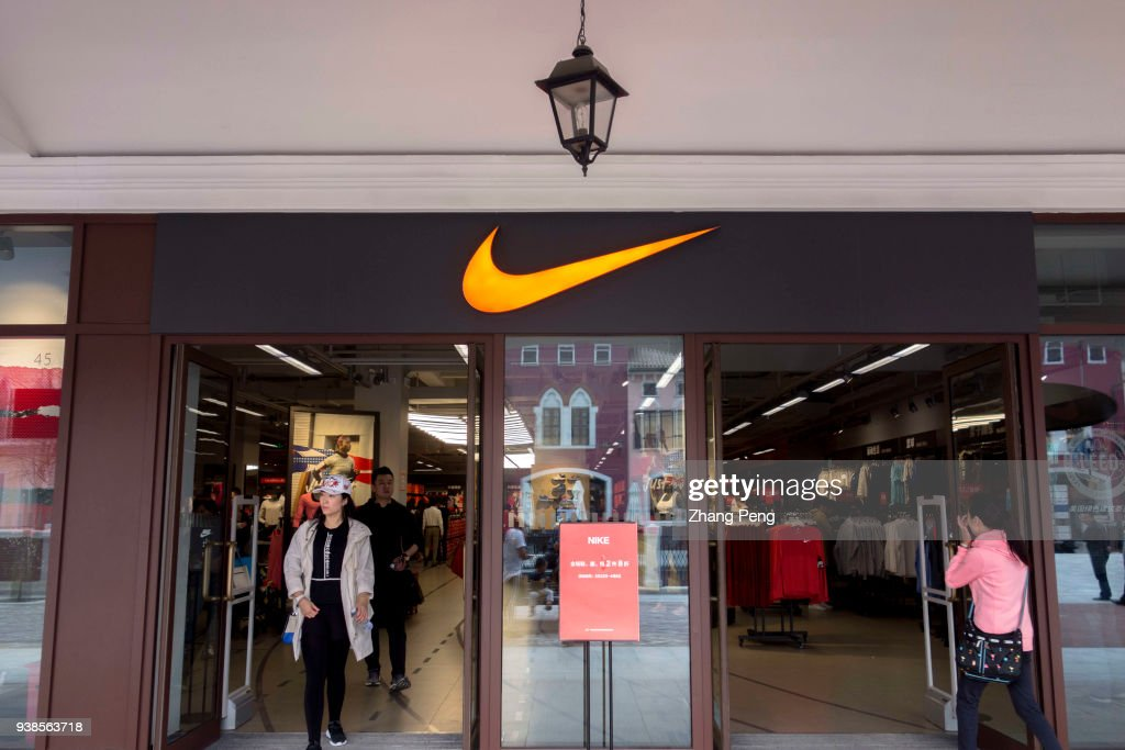 low priced 8e10f bef74 A Nike outlet shop in Tianjin Florentia Village. Nike...  News Photo