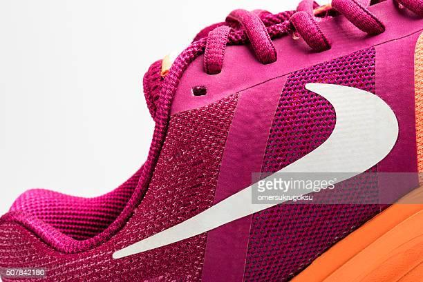 nike pegasus design shoe and logo - nike sports shoe stock pictures, royalty-free photos & images