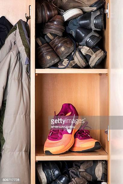 nike pegasus sports women's shoes - orange shoe stock photos and pictures