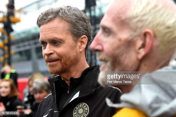 Nike President and CEO Mark Parker and Sandy Bodecker VP action Sport at Nike attend on the finish area during the Nike Breaking2 SubTwo Marathon...