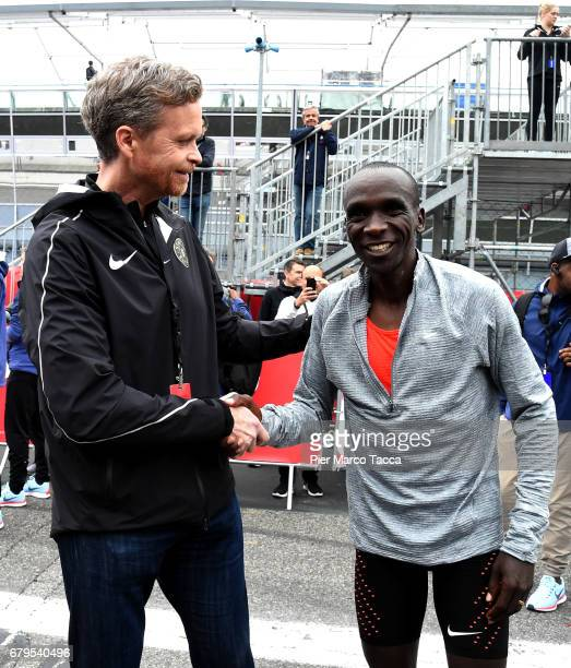Nike President and CEO Mark Parker shakes hand with Eliud Kipchoge at on the arrive during the Nike Breaking2 SubTwo Marathon Attempt at Autodromo di...