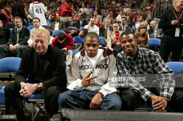 Nike president Phil Knight rapper JayZ and Cincinnati Red's outfielder Ken Griffey Jr watch the Cleveland Cavaliers take on the Denver Nuggets...