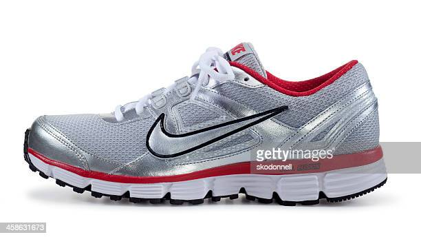 nike runnig shoe on white - nike sports shoe stock pictures, royalty-free photos & images