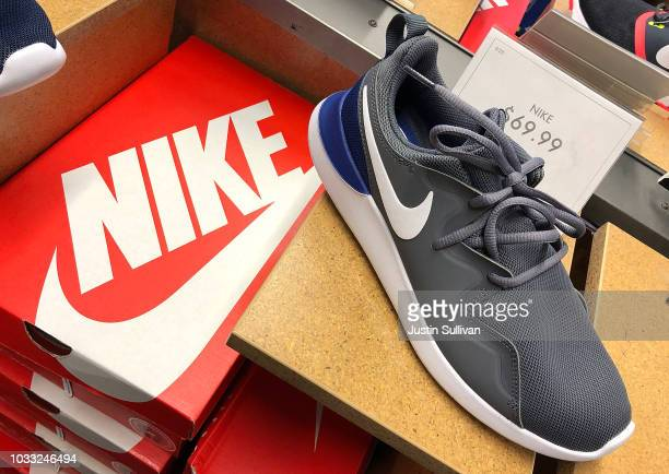 Nike running shoes are displayed at a DSW store on September 14 2018 in San Francisco California A week after Nike released a 'Just Do It' ad...