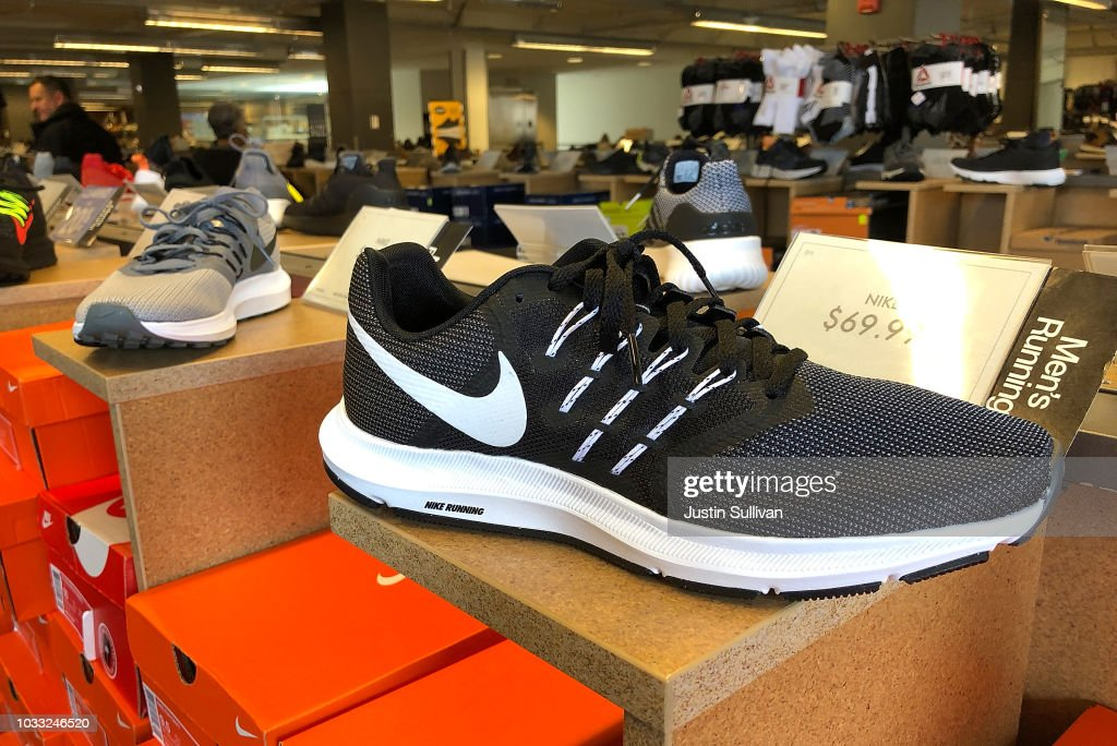 Nike running shoes are displayed at a DSW store on September 14, 2018 in San Francisco, California. A week after Nike released a 'Just Do It' ad campaign that featured controversial former NFL player Colin Kaepernick, the company's stock hit an all-time high at the end of the trading day on Thursday.