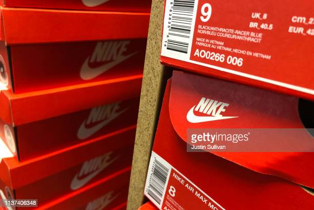 Nike shoes are displayed at a Designer Shoe Warehouse store on March 21 2019 in San Francisco California Nike will report third quarter earnings...