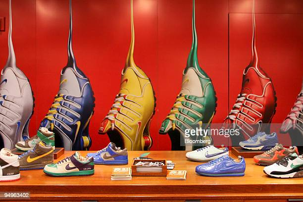 Nike sneakers sit on display at the Niketown store in New York US on Wednesday June 24 2009 Nike Inc the world's largest athleticshoe maker fell in...
