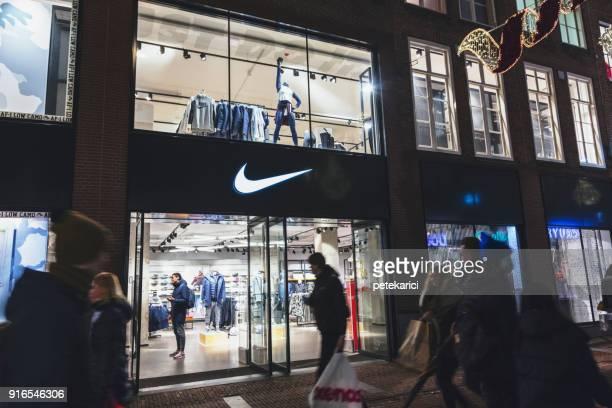 nike sports fashion, amsterdam,netherlands - nike designer label stock pictures, royalty-free photos & images