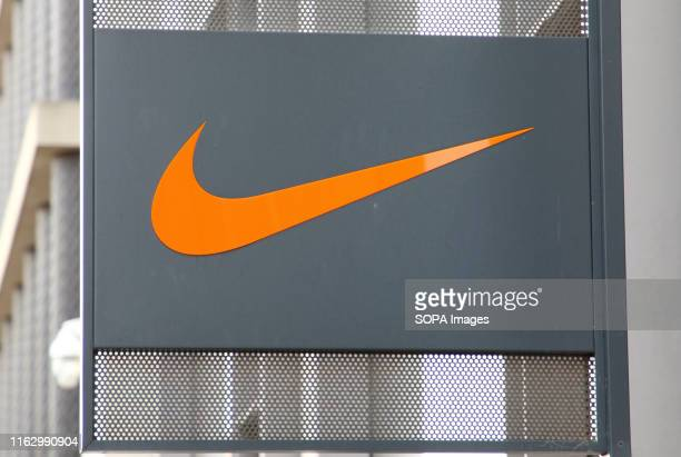 Nike Swoosh logo outside the Nike shop in the recently developed Kings Boulevard and Pancras Square behind London's Kings Cross Rail station