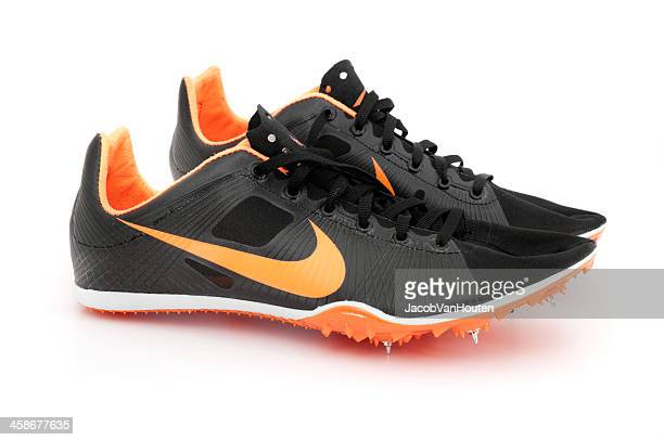 nike zoom victory track spike isolated on white - spiking stock photos and pictures