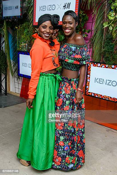 Nikeata Thompson and Aminata Sanogo attend the KENZO x HM PreShopping Event on November 2 2016 in Berlin Germany