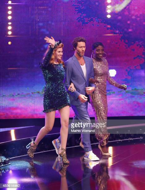 Nikeata Thompson, Howard Donald and Palina Rojinski attend the final of the tv show 'Got to Dance' on August 14, 2014 in Cologne, Germany.