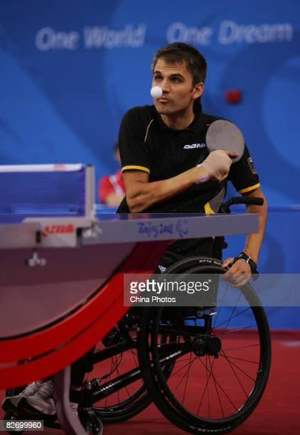 Nikelis Holger of Germany plays against Ducay JeanFrancois of France during a Men's Individual Class 1 game at the Peking University Gymnasium on...