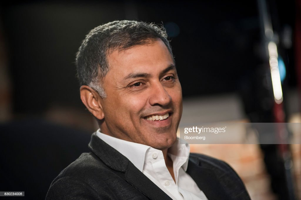Nikesh Arora, advisor and former president of SoftBank Group Corp., smiles during a Bloomberg Studio 1.0 television interview in San Francisco, California, U.S., on Wednesday, Aug. 9, 2017. SoftBank Group Corp. provides telecommunication services. Photographer: David Paul Morris/Bloomberg via Getty Images