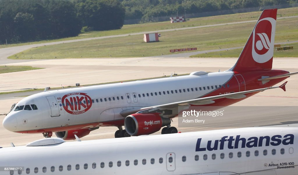 Niki (Top) and Lufthansa airplanes are seen on the tarmac at Tegel Airport (TXL) on August 23, 2017 in Berlin, Germany. Air Berlin's creditors are meeting to discuss acquisition of the insolvent carrier's assets. The airline has been in talks with interested parties since last week after filing for bankrupty when its major shareholder, Etihad, backed out of its funding. Lufthansa, also interested in Air Berlin's Austrian subsidy Niki, Thomas Cook, easyJet and Ryanair are all said to be participating in discussions.