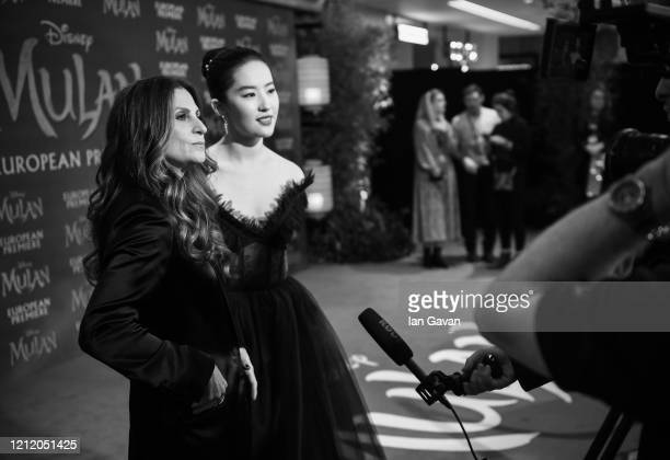 Niki Caro and Yifei Liu attend the European Premiere of Disney's MULAN at Odeon Luxe Leicester Square on March 12 2020 in London England