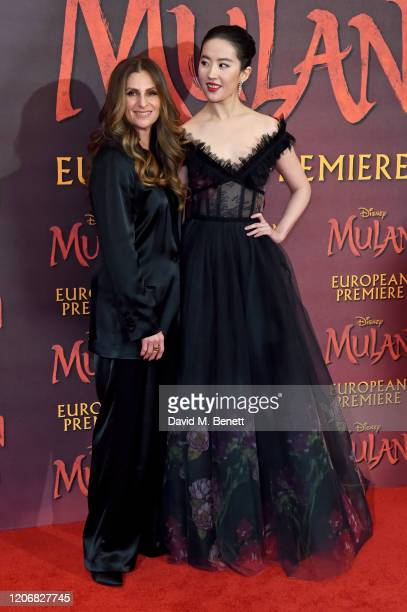 Niki Caro and Yifei Liu attend the European Premiere of Mulan at Odeon Luxe Leicester Square on March 12 2020 in London England
